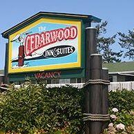 Cedarwood Inn & Suites logo